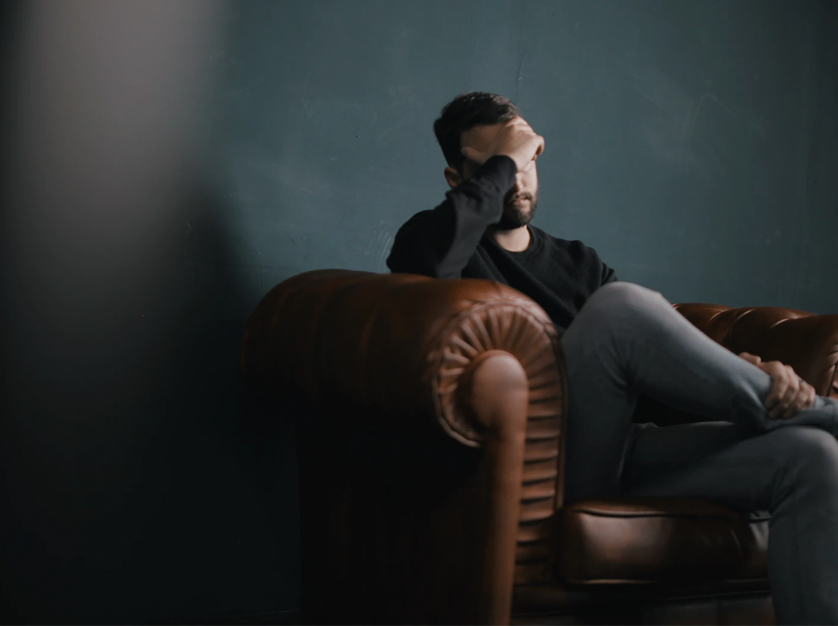 man sitting in chair, frustrated